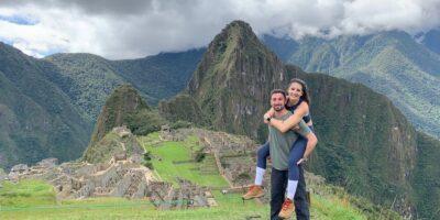 a happy couple in Machu Picchu