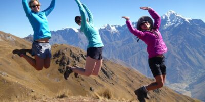 Ancascocha Trek + Inca Trail 7 DaysBeautiful photo and young ladies jumping in front of a snowy mountain in the Ancascocha trail 7 days