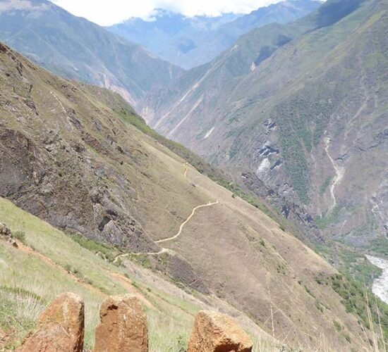 a look at the Choquequirao trail surrounded by beautiful landscapes and a river