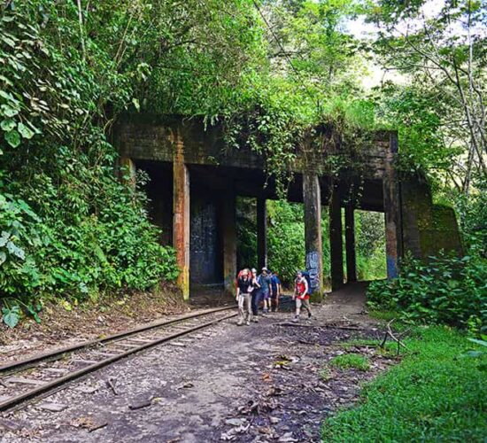 We are walking along the train track to Machu Picchu town