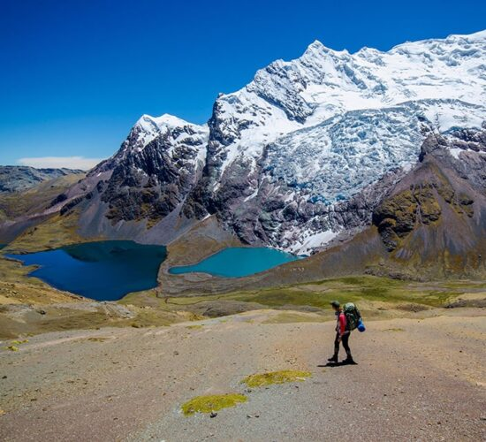 A beautiful view of the pucacocha lake and the ausangate mountain in the ausangate hike 2 days + the rainbow mountain