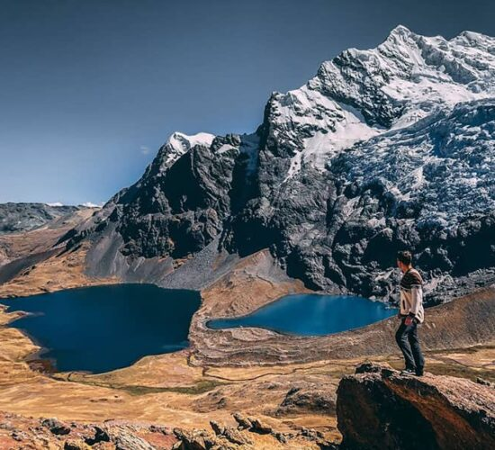 This is how pucacocha lake looks next to the snowy mountain in ausangate trek