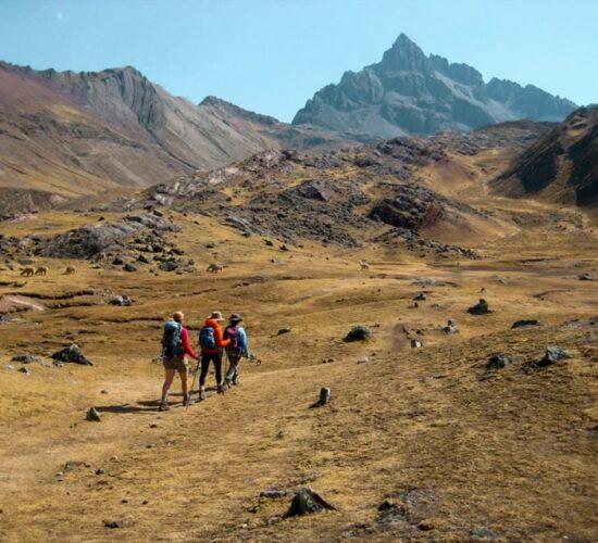 Walking through beautiful landscapes on the Ausangate trek to the rainbow mountain 2 days