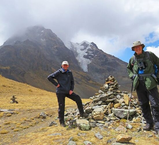 Abra Kuychiccasaour clients happy in the ancascocha trek 5 days next to snowy mountains