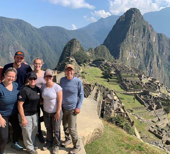 Group of family very happy when arriving at Machu Picchu