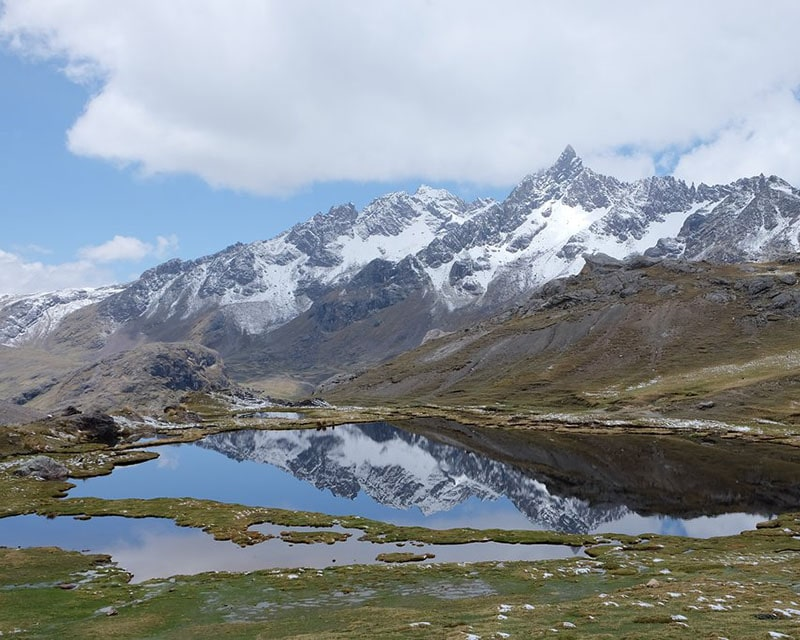Enjoy beautiful views of lakes and snowy mountains on the Ausangate 7 day trek
