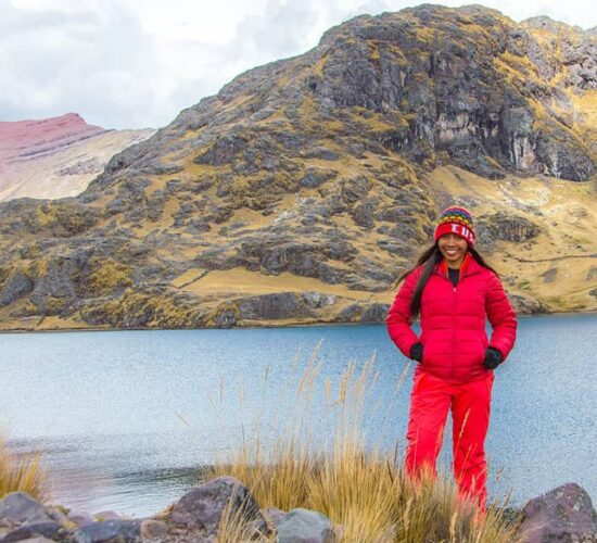 Pucacocha LakeOur female passenger is very happy next to Lake Pucacocha on the Ausangate 5 day trek