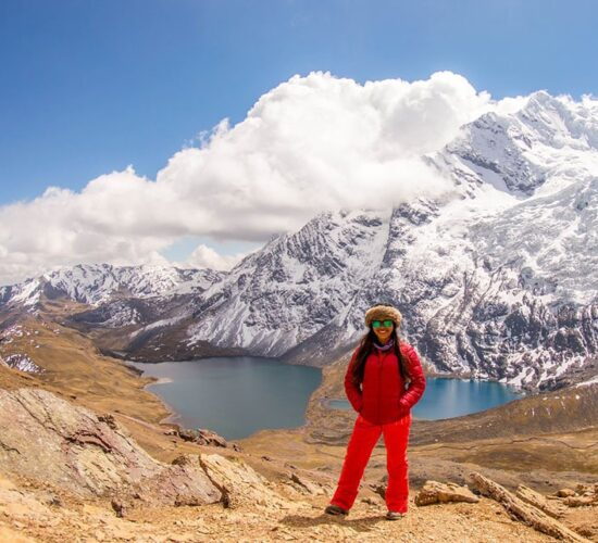 Beautiful photo of a passenger and the pucacocha lake and the ausangate mountain, without a doubt the ausangate trek 5 days is the best.