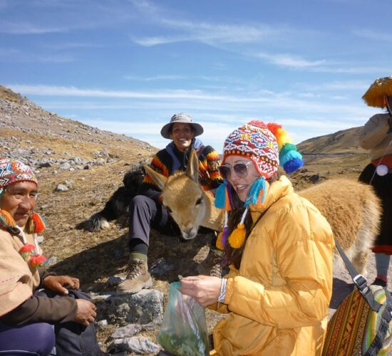 Vicuña with our passenger with Andean people in Ausangate Trek 5 Days