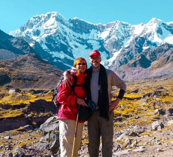 A photo with background back of Ausangate snowy mountain on the Ausangate and Rainbow Mountain trek 4 days