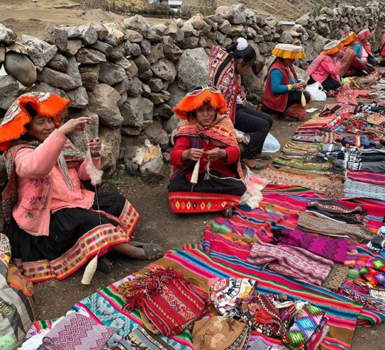 on the lares trail we will meet artisan women selling Andean fabrics